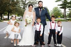 Bride and groom with their flower girls and ring bearers - shot by Rachel Pray | Ashley Gerrity Photography :: Woodcrest Country Club Wedding