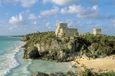 Head 80 miles south of Cancun, Mexico, to discover the more than 700-year-old Mayan ruins of Tulum. A massive limestone wall around the hilltop city protects the remains of a castle, a temple, and artifacts left by seafaring traders. Below is the Caribbean ocean, affording visitors with extraordinary cerulean views.