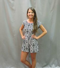 We are in love with this dressy romper from c.luce!  It has a great dressy short cut and bra friendly tie back with super stylish black and white aztec print and hot coral piping detail!  Work this lovely at any indoor or outdoor gathering!
