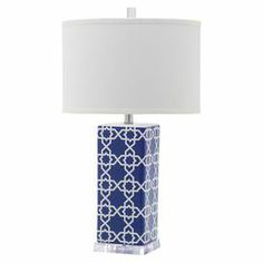 "Showcasing an exotic Moroccan tile-inspired motif in navy blue with a crisp white drum shade, this chic table lamp is a perfect addition to your reading nook or nightstand.   Product: Set of 2 table lampsConstruction Material: Ceramic, acrylic and cottonColor: Navy and whiteAccommodates: (1) CFL bulb each - not includedDimensions: 27"" H x 15"" Diameter"