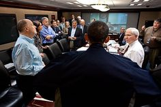 President Barack Obama talks with members of the national security team at the conclusion of one in a series of meetings discussing the mission against Osama bin Laden, May 1, 2011. Gen. James Cartwright, Vice Chairman of the Joint Chiefs of Staff, is seen on the screen