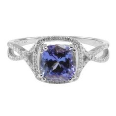 its a tanzanite but it looks so much like my blue topaz (even down to the setting).
