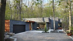 This dark brick home has made a life for itself in the forest   CONTEMPORIST