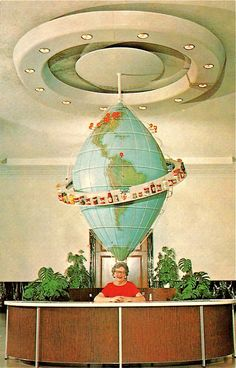 I wish the front desk at work looked like this, as if the receptionist were balancing the Globe O' Condiments on her head. Best front desk ever!