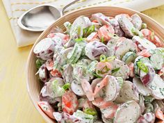 Garden Potato Salad : This lightened-up version of classic potato salad is dressed with a light mayo-yogurt mixture, and is brimming with fresh cilantro and parsley. Carrots and cucumber add crunch to the mix.