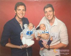James and Oliver Phelps holding babies
