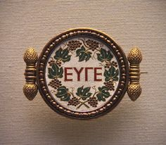 A Greek inscription, 'Bravo' mosaic, set in a gold brooch by Castellani, about 1860