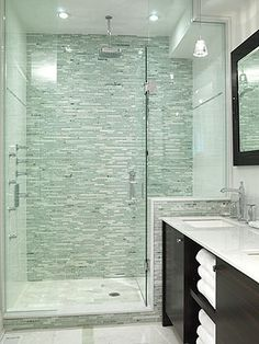 "Love the tile in the shower.   Modern, but softness with the seagreen glass subways tiles and frameless glass doors. (from HGTV show ""Sarah's House"") #bathroom  Then include large, white tiles on the floor.  Continue the subway tile along the wall at and a 4 in or so band of the shower tiles around the bathroom.  Love this!"