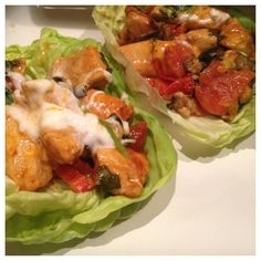 Boston lettuce wrap chicken fajitas with tomatoes, red peppers, olives, and cilantro.