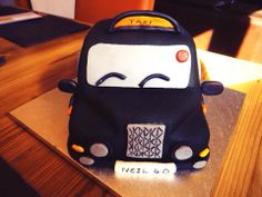 Vanilla and strawberry cake decorated as a London black cab