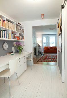 This is what I was thinking of for your dining area.  Simple built in desks with some storage underneath.  You could add shelving above or leave wall blank