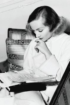 Carole Lombard reading the script on the set of Swing High, Swing Low, 1937