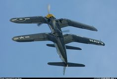 F4U Corsairs, synchronized roll...very cool.