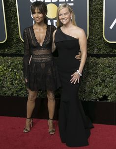 Reese Witherspoon, wearing a one-shoulder mermaid Zac Posen gown, posing with Halle Berry at the 2018 Golden Globe Awards held at the Beverly Hilton Hotel in Beverly Hills, California, on January 7, 2018