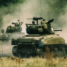 66th Armored Regiment Shermans kicking up the dust cross country