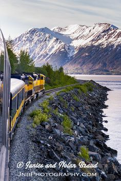 Alaska Railroad - Coastal Classic Train. Incredible scenic train ride through the huge national forests and the Chugach mountains and the Kenai mountains between Anchorage and Seward, Alaska.
