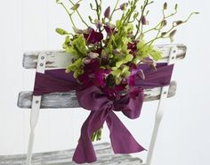 Google Image Result for http://www.wedbits.com/wp-content/uploads/2011/05/Orchid-chair-back-wedding-flower-decoration-450x353.jpg