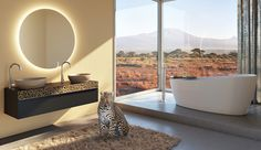 Homeplaza: Badezimmerkollektion - Möbel mit Leoparden-Motiv setzen Akzente Bathroom Lighting, Bathtub, Mirror, Furniture, Home Decor, Remodels, Bathing, Bathroom Light Fittings, Standing Bath