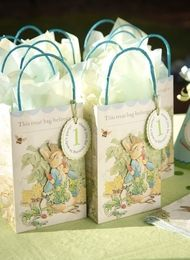 Peter Rabbit party favor bags with the personal touch of a personalized medallion. All bags come with coordinating tissue. | #peterrabbitparty #bunnyparty #peterrabbitbabyshower