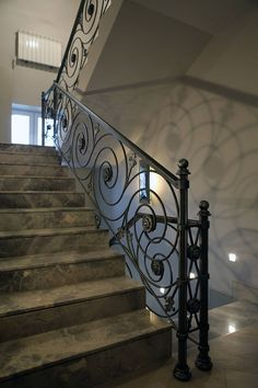 Wrought iron stair railings with elements of cast steel