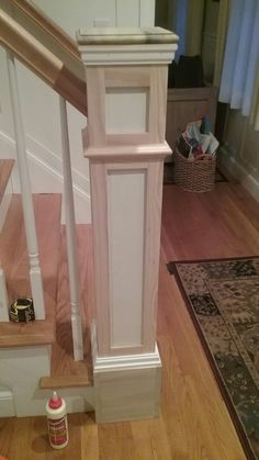 Building over standard newel post for an updated Craftsmen look to match the board and batten walls