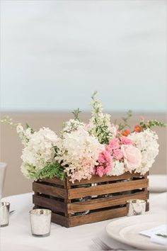pink and white floral centerpiece held in wooden DIY paint stick container