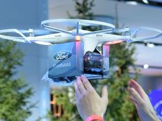Ford Motor Co.'s drone is again flying at its North American International Auto Show display after the Detroit Fire Department temporarily grounded it over safety concerns Monday night.