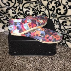 Limited edition floral Toms Pre loved but still in fair condition! No rips or tears. Pretty vibrant colors perfect for the spring/summer time! Size 6.5 women's. TOMS Shoes