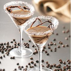 Coffee & Cream Martini (2 Tbs coarse sugar  1 tsp finely ground coffee 1-1/2 oz vodka  1-1/2 oz Kahlua 1-1/2 oz Irish cream liqueur  Chocolate syrup)