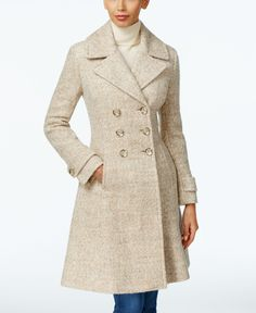 Cut in a chic, A-line silhouette, Ivanka Trump's peacoat is crafted neutral hues blended together in melange fabric. | Wool/polyester; lining: polyester | Dry clean | Imported | Notched collar | Doubl