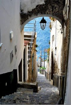 Alleyway leading to the sea in Praiano a town in southwest Italy. It is situated on the Amalfi Coast, between the towns of Amalfi and Positano. Positano, Oh The Places You'll Go, Places To Travel, Places To Visit, Amalfi Coast, Capri Italia, Turin, Naples, Dream Vacations