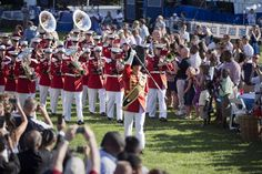 Guests watch the arrival of the Marine Band during Independence Day celebrations on the South Lawn of the White House in Washington