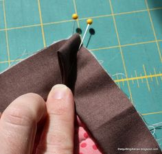 """Binding a quilt is the final step in finishing. Before you bind, you need to somehow """"quilt"""" your quilt. This means to attach the front and back, with batting in between. I usually machine quilt (or have someone else do it) my quilts these days. There are good tutorials for that here, here, and here. …"""