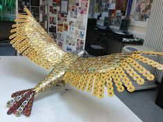 This is a bird sculpture made out of beer bottle caps. While cool in real life, Fallout fans would use all those caps to buy weapon schematics or some Stimpaks.