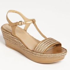 """Stuart Weitzman Flatty sandals Burnished gold dominates a T-strap sandal set on an easy wedge platform. Approx. heel height: 2"""" with 1 1/2"""" platform. Measurements taken from size 8.5 and may vary slightly by size. Adjustable strap with buckle closure. Leather upper and lining/rubber sole. By Stuart Weitzman; made in Spain. Worn maybe 2-3 times, super comfortable. The only sign of wear are minor scuffs (last photo), not noticeable when worn. True to size. Stuart Weitzman Shoes Sandals"""