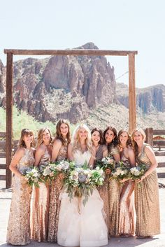 Mismatched rose gold bridesmaid dresses. I had my bridesmaids rent long sequin blush gowns from Rent The Runway. They turned out perfectly! Photo credit: April Maura Photography