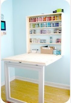 Space Saving Craft Room Desk LOVE this craft table! Great for storage and folds up out of the way! Plus the legs are made out of molding so when the table is put away, it looks like a framed picture! Craft Paint Storage, Acrylic Paint Storage, Kids Craft Storage, Ikea Paint, Room Paint, Diy Casa, Space Crafts, Craft Space, Craft Desk