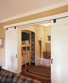 Sliding barn doors.  Could be awesome for boys room as a kids' play place.