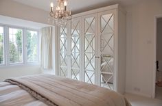 Mirrored wardrobes with fretwork - bespoke design for client.