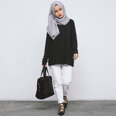 Pinterest: @eighthhorcruxx. White trousers, black top, grey hijab and black lace up flats.