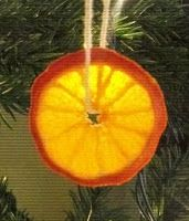 Dried citrus ornaments for Christmas. Super easy to make, just pop them in the oven for a while and string them up in the tree!