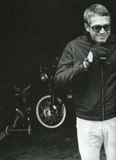 Steve McQueen in a black quilted jacket & sunglasses