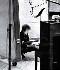 Jerry Schatzberg's shot of Bob Dylan in a New York studio. Unusual in that the singer is unguarded, and not posing for the camera – was taken in June 1965, during the recording of the Highway 61 Revisited album.