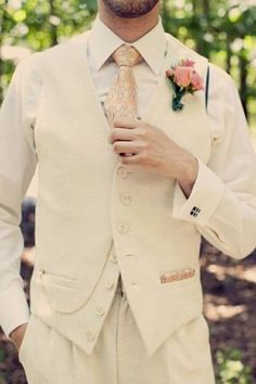 Cream and gold with a pink boutonniere: A look for the vintage groom