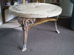 Cable reel spool top coffee table with repurposed aluminium outdoor chair legs.  I found the reel spool top only, the rest of the reel had rotted away. I found the three legs at the dump shop and they were perfect.