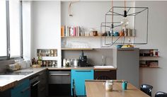 Grey and blue kitchen with wire lights.