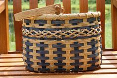 Kriss Kross Basket by BlueFrogBasketry on Etsy, $55.00  -  I had no idea that baskets were selling for this much money. Unless you're really fast, you aren't making much money at this, but I'm guessing this is more fun than working any minimum wage job for someone else.