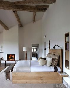 INFURN:: Gorgeous ancient wood beams combined with a modern bed! Truly stunning!