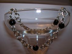 http://www.allfreejewelrymaking.com/Chain-Bracelet/2-in-2-Chain-Maille-and-Bead-Bracelet-Part-1/ct/1