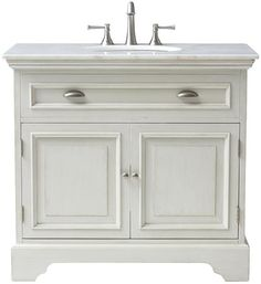 Sadie Single Vanity  - comes in two colors and includes white marble top.  This is pretty and says farmhouse more to me...pair with a modern faucet and more modern lighting.